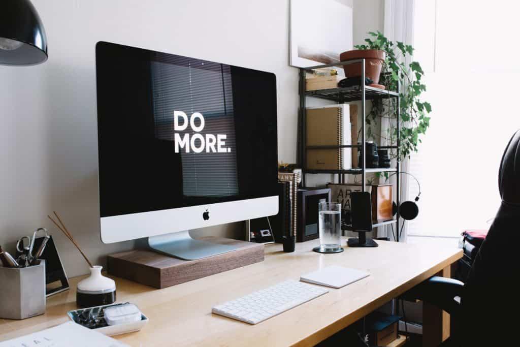 """do more"" written on computer screen"