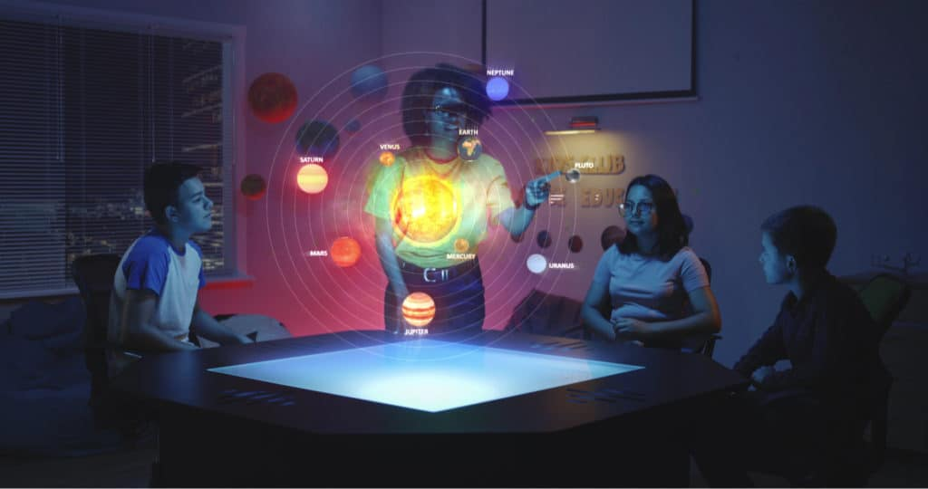teacher and her students looking at a solar system hologram